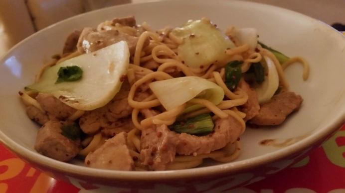 Marinated pork fillet with noodles and pak choii